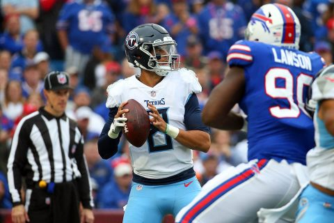 Tennessee Titans quarterback Marcus Mariota (8) drops back to pass as Buffalo Bills defensive end Shaq Lawson (90) pressures during the second quarter at New Era Field. (Rich Barnes-USA TODAY Sports)