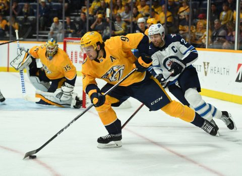 Oct 11, 2018; Nashville, TN, USA; Nashville Predators left wing Filip Forsberg (9) skates with the puck away from Winnipeg Jets right wing Blake Wheeler (26) during the second period at Bridgestone Arena. Mandatory Credit: Christopher Hanewinckel-USA TODAY Sports