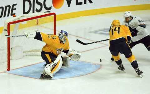 Nashville Predators goaltender Juuse Saros (74) makes a save on a shot by San Jose Sharks right wing Kevin Labanc (62) during the first period at Bridgestone Arena. Mandatory Credit: Christopher Hanewinckel-USA TODAY Sports