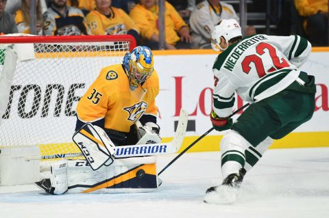 Nashville Predators goaltender Pekka Rinne (35) makes a save on a shot by Minnesota Wild right wing Nino Niederreiter (22) during the third period at Bridgestone Arena. Mandatory Credit: Christopher Hanewinckel-USA TODAY Sports