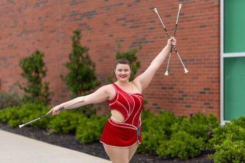 Austin Peay State University freshman feature twirler Izzy Melvin displays her three batons outside the APSU Art + Design building.