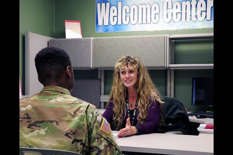 Patient Welcome Center nurse Brandy Robertson provides information to a Soldier about health and wellness services available on Fort Campbell to him and his family. Robertson can help beneficiaries navigate through TRICARE service changes, raise awareness about online resources and determine what resources patients may need for their medical needs. (U.S. Army photo by Maria Yager)