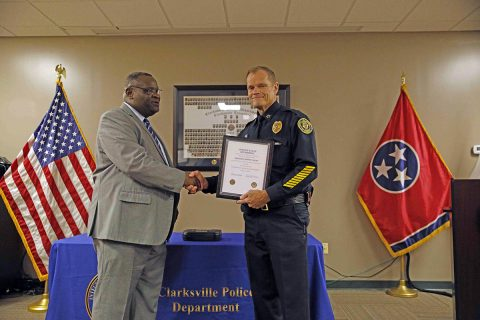 Clarksville Police Chief Al Ansley gives Sergeant John W. Hunt a retirement certificate during Hunt's retirement ceremony at Clarksville Police Headquarters.