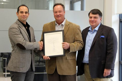 Florim USA CEO Marco Fregni (left) and Florim USA Environmental Manager Don Haynes (right) receive the 2017 Tennessee Valley Authority Carbon Reduction Award from Cumberland Electric Membership Corporation General Manager Chris A. Davis (center).