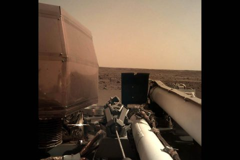 The Instrument Deployment Camera (IDC), located on the robotic arm of NASA's InSight lander, took this picture of the Martian surface on Nov. 26, 2018, the same day the spacecraft touched down on the Red Planet. The camera's transparent dust cover is still on in this image, to prevent particulates kicked up during landing from settling on the camera's lens. (NASA/JPL-Caltech)