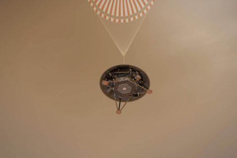 This illustration shows a simulated view of NASA's InSight lander descending on its parachute toward the surface of Mars. (NASA/JPL-Caltech)