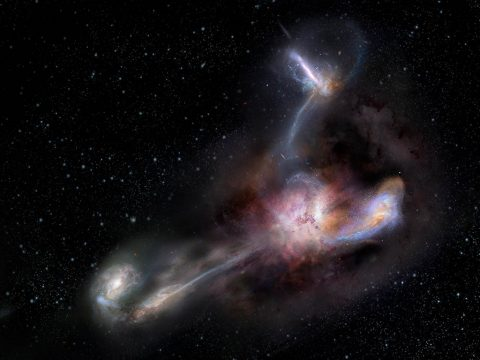 This artist's impression shows galaxy WISE J224607.55-052634.9, the most luminous galaxy ever discovered. A new study using data from the Atacama Large Millimeter/submillimeter Array (ALMA) shows that this galaxy is syphoning dust and other material from three of its smaller galactic neighbors. )(NRAO/AUI/NSF) S. Dagnello)