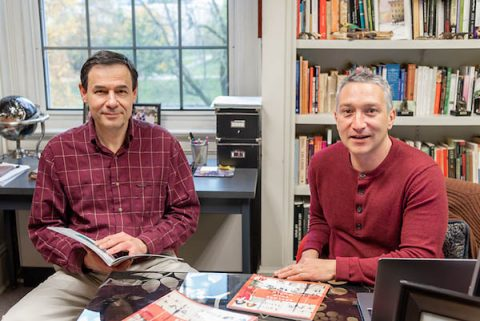 "Austin Peay State University professors Dr. Sergi Markov and Dr. Osvaldo Di Paolo Harrison review the first issue of ""Explore Your World."""