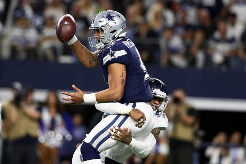 Dallas Cowboys quarterback Dak Prescott (4) is sacked in the fourth quarter by Tennessee Titans linebacker Harold Landry III (58) at AT&T Stadium. (Matthew Emmons-USA TODAY Sports)