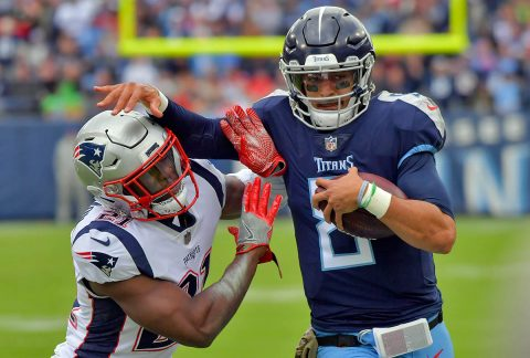 Tennessee Titans quarterback Marcus Mariota (8) rushes against New England Patriots strong safety Duron Harmon (21) during the second half at Nissan Stadium. Tennessee won 34-10 on November 11th, 2018. (Jim Brown-USA TODAY Sports)