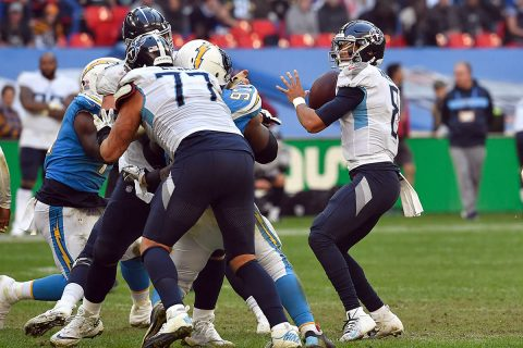 Tennessee Titans quarterback Marcus Mariota (8) looks downfield to pass during the second half against the Los Angeles Chargers during an NFL International Series game at Wembley Stadium. (Steve Flynn-USA TODAY Sports)
