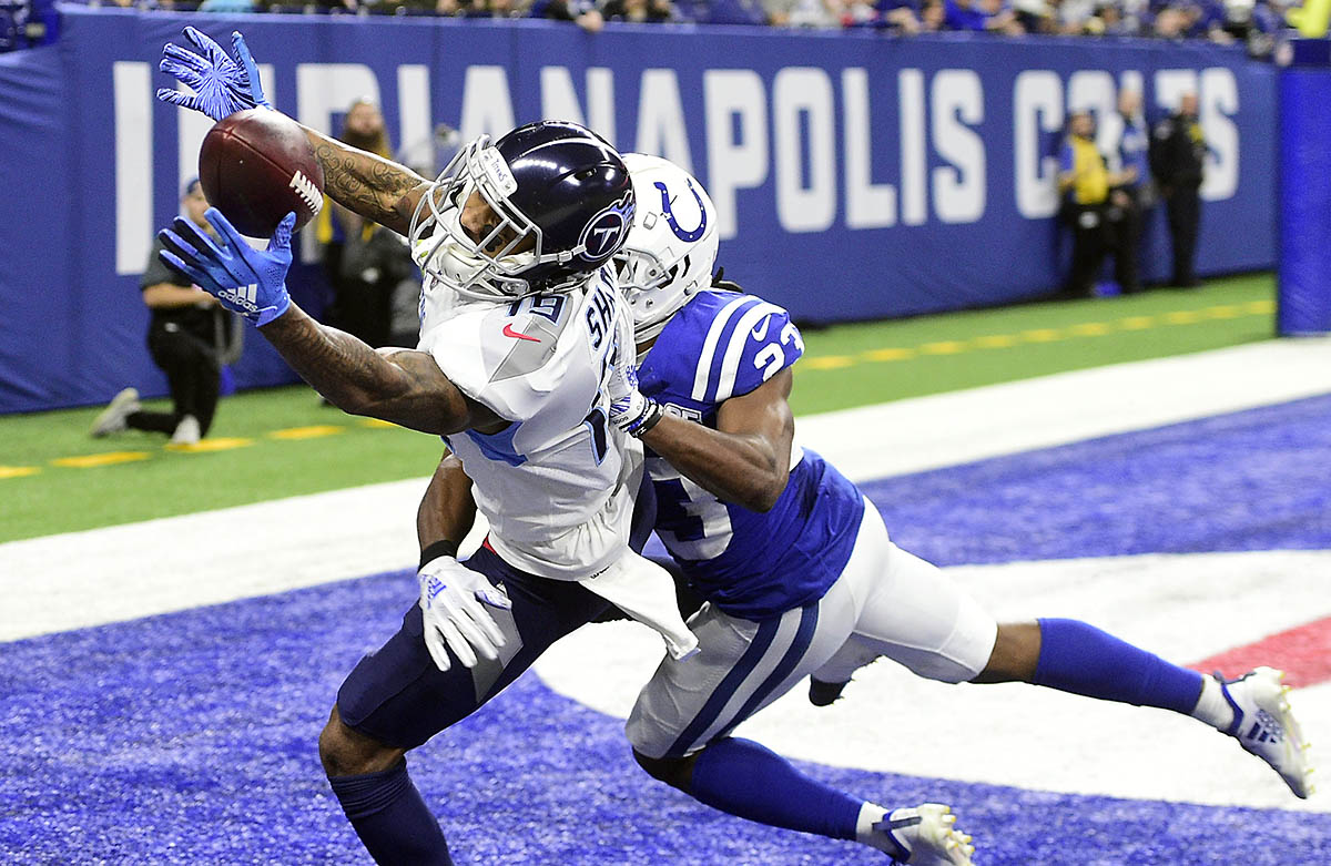 Tennessee Titans receiver Tajae' Sharpe (19) makes a diving catch for a touchdown over Indianapolis Colts corner back Kenny Moore II (23) in the second half at Lucas Oil Stadium on November 18th, 2018.