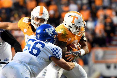 Tennessee Volunteers running back Tim Jordan (9) runs the ball against Kentucky Wildcats linebacker Kash Daniel (56) during the second half at Neyland Stadium. Tennessee won 24 to 7. (Randy Sartin-USA TODAY Sports)