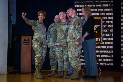 At a Fort Campbell community town hall, Lt. Gen. Nadja West, U.S. Army surgeon general and commander of Army Medical Command, takes a selfie with Soldiers and Army Civilians after presenting coins for individual accomplishments. (U.S. Army photo by David E. Gillespie)