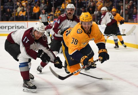 Nashville Predators right wing Ryan Hartman (38) is tripped by Colorado Avalanche center Tyson Jost (17) as he battles for a puck during the third period at Bridgestone Arena. (Christopher Hanewinckel-USA TODAY Sports)