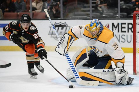 Anaheim Ducks left wing Pontus Aberg (20) moves in for the puck against Nashville Predators goaltender Pekka Rinne (35) during the second period at Honda Center. Mandatory Credit: Gary A. Vasquez-USA TODAY Sports