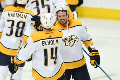 Nashville Predators defenseman Mattias Ekholm (14) is greeted by center Ryan Johansen (92) after their win over the Dallas Stars during overtime at American Airlines Center. Mandatory Credit: Shanna Lockwood-USA TODAY Sports