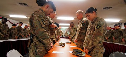 Soldiers of the 101st Resolute Support Sustainment Brigade bow their heads in prayer during the invocation for a prayer dinner. Attendees rejoiced with their unit counterparts through prayer, live music, and scripture teachings at Bagram Airfield, Afghanistan. (1st Lt. Verniccia Ford, 101st Airborne Division (AA) Sustainment Brigade Public Affairs)