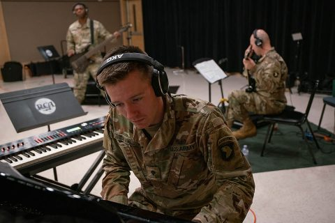 Spc. Michael Davis, pianist, 101st Airborne Division Air Assault Band plays the piano while recording 'Light of the Gold Star' at Columbia Studio A in Nashville on October 26. (US Army photo by Sgt. Patrick Kirby, 40th PAD)