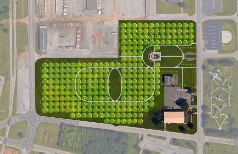 At the bottom of this aerial view of the new Task Force 3-502nd Memorial at Fort Campbell, Kentucky, you can see the original memorial. The new memorial is nearly five times the size of the original and will provide ample space for the 256 sugar maples to flourish. There also will be walkways throughout the memorial with on oval opening among the trees where Gander Families hope to eventually place benches. (Courtesy Graphic)
