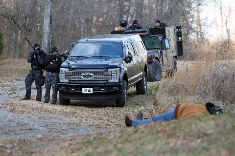 A pretend suspect waits to for 'Strike Team 3' to apprehend him during an interagency training operation Nov. 27, at the Public Safety Training Center in Clarksville, Tennessee. The training included members of the 163rd Military Police Department Special Reaction Team, the Montgomery County Sherriff's Office Emergency Services Unit and the Clarksville Police Department.  (Pfc. Lynnwood Thomas, 40th Public Affairs Detachment)
