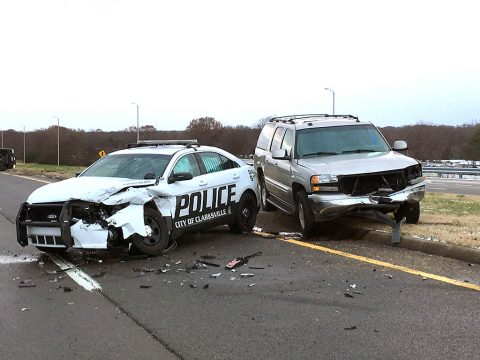 A vehicle slides on the icy road and crashes into an unoccupied patrol car. (Sgt Ferguson, CPD)