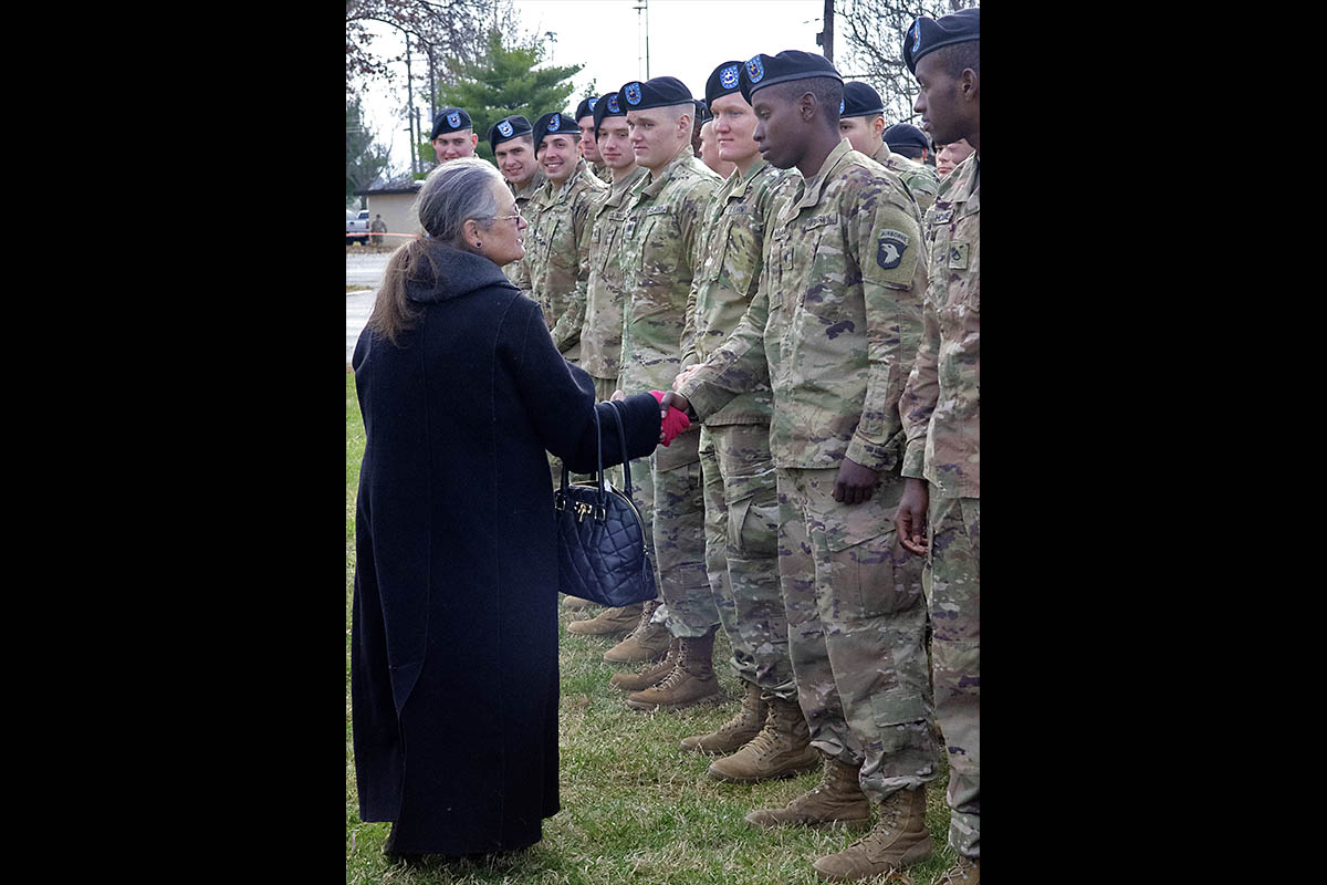 Amy Gallo, a Gander widow, shakes hands with 2nd Brigade Combat Team, 101st Airborne Division (Air Assault) Soldiers Wednesday, December 12th, 2018, following the final remembrance ceremony at Task Force 3-502nd Memorial Park at Fort Campbell, Kentucky. (Maria Rice McClure, Fort Campbell Courier/Fort Campbell Public Affairs)