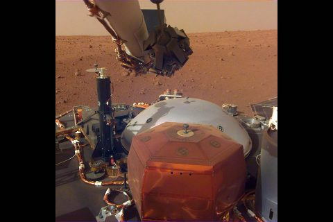 This image from InSight's robotic-arm mounted Instrument Deployment Camera shows the instruments on the spacecraft's deck, with the Martian surface of Elysium Planitia in the background. The image was received on Dec. 4, 2018 (Sol 8). (NASA/JPL-Caltech)