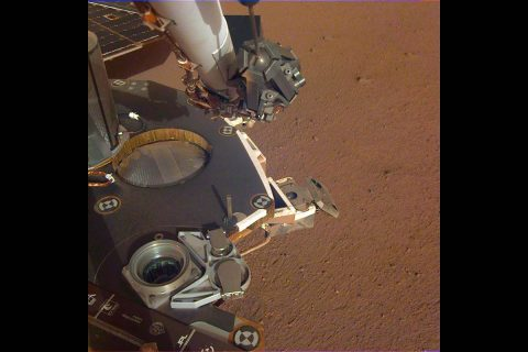 A partial view of the deck of NASA's InSight lander, where it stands on the Martian plains Elysium Planitia. The image was received on Dec. 4, 2018 (Sol 8). (NASA/JPL-Caltech)