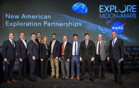 NASA Administrator Jim Bridenstine, left, and Associate Administrator for the Science Mission Directorate Thomas Zurbuchen, right, join with representatives of nine U.S. companies that are eligible to bid on NASA delivery services to the lunar surface through Commercial Lunar Payload Services contracts Thursday, Nov. 29, 2018, at NASA Headquarters in Washington. (NASA/Bill Ingalls)