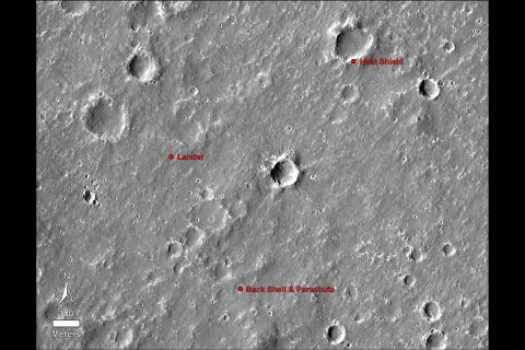 An annotated image of the surface of Mars, taken by the HiRISE camera on NASA's Mars Reconnaissance Orbiter (MRO) on May 30, 2014. The annotations - added after InSight landed on Nov. 26, 2018 - display the locations of NASA's InSight lander, its heat shield and parachute. (NASA/JPL-Caltech/University of Arizona)