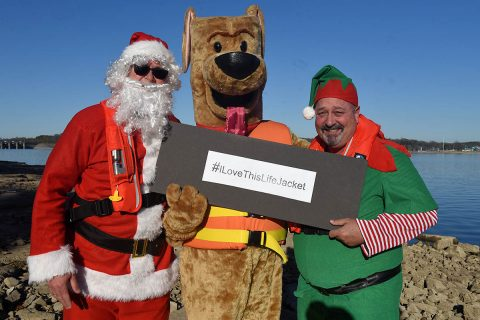 "Safety Santa, Bobber the Water Safety Dog, and Hap ""Hazard"" the Elf film a holiday safety public service announcement Dec. 17, 2018 at J. Percy Priest Lake in Nashville, Tenn., to encourage the public to be vigilant and safe at home this Christmas and when visiting and recreating at Corps of Engineers lakes. (Leon Roberts, USACE)"