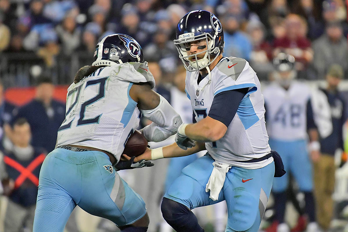 Tennessee Titans quarterback Blaine Gabbert (7) hands off to Tennessee running back Derrick Henry (22) during the second half against the Washington Redskins at Nissan Stadium. Tennessee won 25-16. (Jim Brown-USA TODAY Sports)