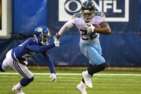 Tennessee Titans running back Derrick Henry (22) runs past New York Giants cornerback Janoris Jenkins (20) during the 2nd quarter at MetLife Stadium. (Robert Deutsch-USA TODAY Sports)