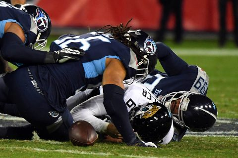 Tennessee Titans defensive end Jurrell Casey (99) forces Jacksonville Jaguars quarterback Cody Kessler (6) to fumble as it is recovered by Tennessee Titans linebacker Sharif Finch (56) during the second half at Nissan Stadium. (Christopher Hanewinckel-USA TODAY Sports)