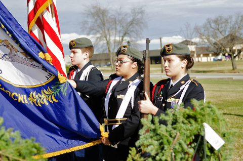During a Wreaths Across America ceremony Saturday, Dec. 15, 2018, at 101st Airborne Division (Air Assault) Headquarters, Fort Campbell, Kentucky, the colors were presented by the Northwest High School, Clarksville, Tennessee, JROTC color guard – Devon Brooks, freshman (left); Makaya Lane, sophomore; and Taylor Rel, sophomore. Not pictured is Serena Henderson, senior. (Mari-Alice Jasper, Fort Campbell Courier)