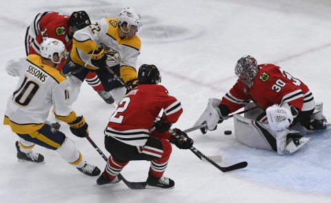 Dec 18, 2018; Chicago, IL, USA; Chicago Blackhawks goaltender Cam Ward (30) defends against Nashville Predators left wing Kevin Fiala (22) and Nashville Predators center Colton Sissons (10) during the first period at the United Center. Mandatory Credit: Matt Marton-USA TODAY Sports