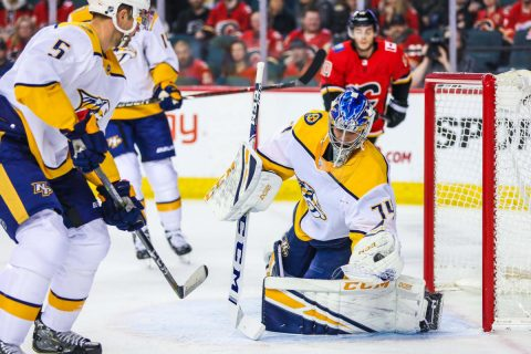 Dec 8, 2018; Calgary, Alberta, CAN; Nashville Predators goaltender Juuse Saros (74) makes a save against the Calgary Flames during the first period at Scotiabank Saddledome. Mandatory Credit: Sergei Belski-USA TODAY Sports