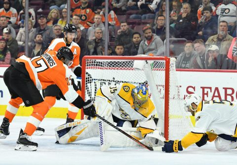 Dec 20, 2018; Philadelphia, PA, USA; Nashville Predators goaltender Pekka Rinne (35) and left wing Austin Watson (51) battle for the puck against Philadelphia Flyers right wing Wayne Simmonds (17) during the second period at Wells Fargo Center. Mandatory Credit: Eric Hartline-USA TODAY Sports