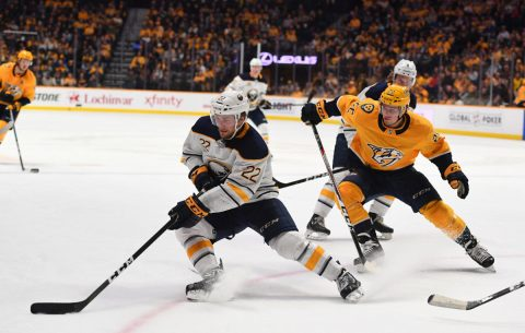 Buffalo Sabres center Johan Larsson (22) handles the puck away from Nashville Predators left wing Kevin Fiala (22) during the second period at Bridgestone Arena. (Christopher Hanewinckel-USA TODAY Sports)