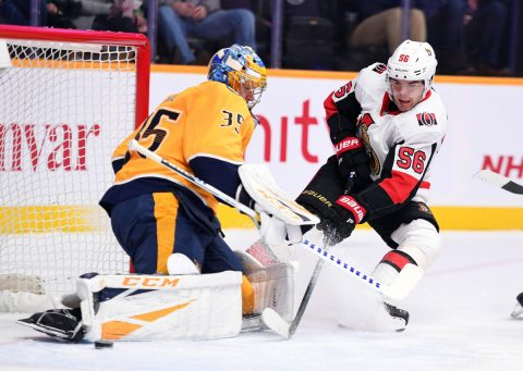 Dec 11, 2018; Nashville, TN, USA; Ottawa Senators left wing Magnus Paajarvi (56) has a shot blocked by Nashville Predators goaltender Pekka Rinne (35) during the first period at Bridgestone Arena. Mandatory Credit: Christopher Hanewinckel-USA TODAY Sports
