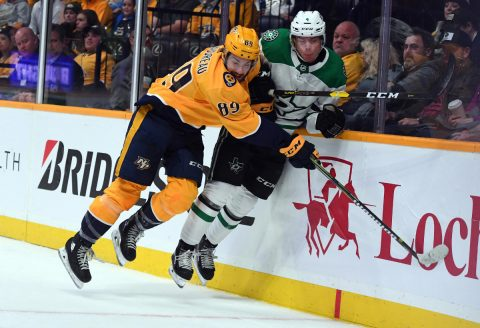 ec 27, 2018; Nashville, TN, USA; Nashville Predators center Frederick Gaudreau (89) hits /Dallas Stars defenseman Miro Heiskanen (4) during the first period at Bridgestone Arena. Mandatory Credit: Christopher Hanewinckel-USA TODAY Sports