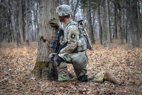 Sgt. David Penney, a Squad Leader with 2nd Battalion, 506th Infantry Regiment, 3rd Brigade Combat Team, 101st Airborne Division, takes cover behind a tree during the battalion-level Live Fire Exercise January 16th. (U.S. Army Photo by Sgt. Aaron Daugherty)