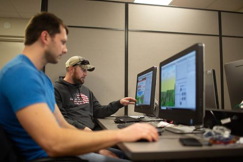Austin Peay State University Computer science students Connar Bielinski and Kevin Lyons work on their simulations.