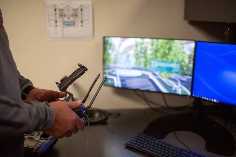 Doug Catellier, Austin Peay State University GIS Center project manager, maneuvers a drone on one of the simulators.