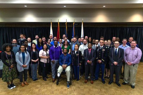 APSU Military graduates earn a specially designed coin and cords from Austin Peay in addition to their degrees. Pictured are the December 2018 honorees.