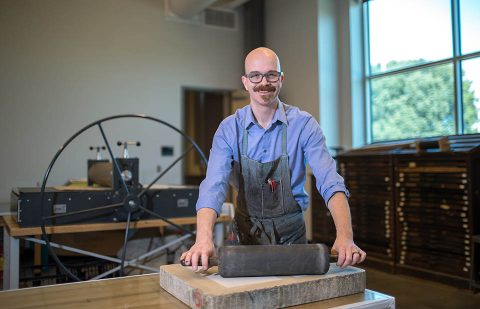 Patrick Vincent, APSU assistant professor, poses in the printmaking studio.