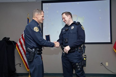 Clarksville Police chief Al Ansley congratulates Officer Steven Deering.