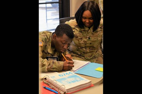 Spc. Devoreh Edem, 129th CSSB, 101st Airborne Division Sustainment Brigade assists Pfc. Charles McKenzie, A Company, 2nd Battalion, 506th Infantry Regiment, 3rd Brigade Combat Team with completing his 2018 tax return.