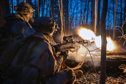 An infantryman from 1st Battalion, 187th Infantry Regiment, 3rd Brigade Combat Team, 101st Airborne Division (Air Assault) provides cover fire with the M240B at Muscatatuck Urban Training Center at Camp Atterbury, Indiana on Dec. 7, 2018. This machine gun fire helped initiate one of the final days of the BCT training exercise which spanned Tennessee, Kentucky and two time zones. (Sgt. Patrick Kirby, 40th Public Affairs Detachment)